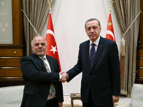 Iraqi Prime Minister Haider al-Abadi shakes hands with Turkey's President Tayyip Erdogan.